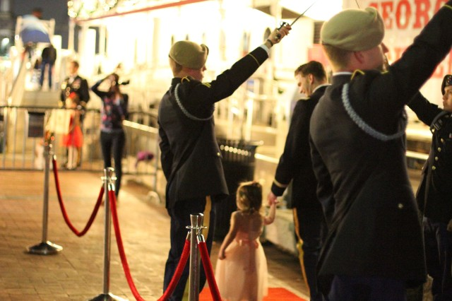 "As the father-daughter couples prepared to board, a herald announced the ""princess's"" names and the dads escorted their daughters down a red carpet, underneath arched sabers."