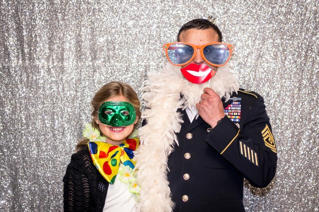 A Ranger 1st Sgt., and his daughter pose for the camera during the Father-Daughter Ball, December 1st, at the Riverboat Georgia Queen.