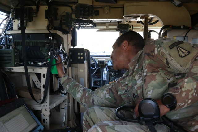 Sgt. 1st Class Douglas King, communication section chief, 4th battalion, 1st Security Force Assistance Brigade, checks communication platforms during a brigade system validation exercise at Fort Benning, Ga. on Nov. 7, 2017. The validation exercise was conducted to test out the systems of the new equipment for the newly formed 1st SFAB. Soldiers interesting in joining the 1st SFAB should contact their branch manager for more information. (U.S. Army photo by Sgt. Joseph Truckley, 50th Public Affairs Detachment/Released)