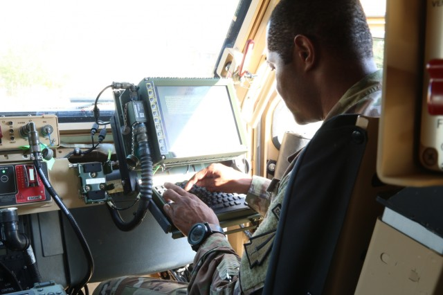 Sgt. 1st Class Douglas King, communication section chief, 4th battalion, 1st Security Force Assistance Brigade, checks his blue force tracker during a brigade system validation exercise at Fort Benning, Ga. on Nov. 7, 2017. The validation exercise was conducted to test out the systems of the new equipment for the newly formed 1st SFAB. Soldiers interesting in joining the 1st SFAB should contact their branch manager for more information. (U.S. Army photo by Sgt. Joseph Truckley, 50th Public Affairs Detachment/Released)