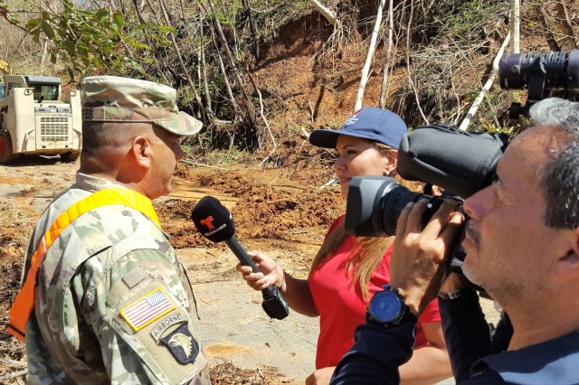 A U.S. Army Reserve Soldier talks to the media about the efforts to clear roads in the center of the island of Puerto Rico, Oct 5, 2017, as part of the emergency response operations that the U.S. Army Reserve provided in the aftermath of hurricane Maria. U.S. Army Reserve PAOs in the island traveled around the U.S. territory, actively facilitating media coverage to remote sites. (U.S. Army photo/released)