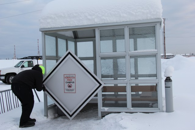 A tobacco-free campus sign serves as a barrier to a smoke-shack located outside of Bassett Army Community Hospital. The sign placed Dec. 1 by Kristopher Wood a laborer assigned to facilities, reminds staff and patients that all Medical Department Activity - Alaska campuses are now tobacco-free. The structures will be removed in the spring when weather permits.