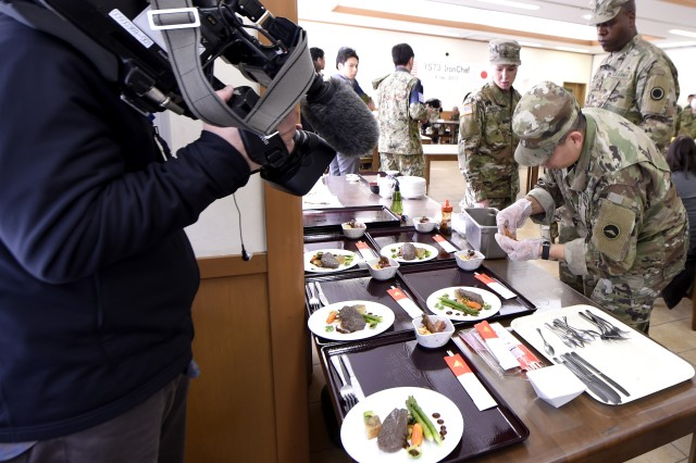 CAMP SENDAI, Japan -- Soldiers assigned to I Corps, Joint Base Lewis-McChord, Washington, Team Mandoline, prepare ingredients for Iron Chef 2017 during exercise Yama Sakura 73. Four teams comprised of American and Japanese forces participated in a friendly cooking competition during the exercise. Yama Sakura is an annual bilateral command post exercise involving the U.S. Military and the Japan Ground Self-Defense Force (JGSDF).The purpose of the exercise is to enhance U.S. and Japanese combat readiness and interoperability while strengthening bilateral relationships and demonstrating U.S. resolve to support the security interests of allies and partners in the Indo-Asia-Pacific region. During the exercise, U.S. military members and JGSDF members exchange ideas, tactics, techniques, military experiences, and culture.  (U.S. Navy Photo by MC2 (SW) Whitehead, Marquis)