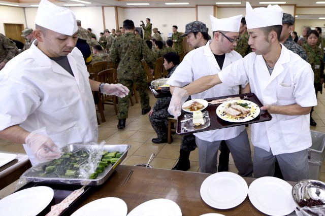 CAMP SENDAI, Japan -- Four teams comprised of American and Japanese forces participated in a friendly cooking competition during the exercise. Yama Sakura is an annual bilateral command post exercise involving the U.S. Military and the Japan Ground Self-Defense Force (JGSDF).The purpose of the exercise is to enhance U.S. and Japanese combat readiness and interoperability while strengthening bilateral relationships and demonstrating U.S. resolve to support the security interests of allies and partners in the Indo-Asia-Pacific region. During the exercise, U.S. military members and JGSDF members exchange ideas, tactics, techniques, military experiences, and culture. (U.S. Navy Photo by MC2 (SW) Whitehead, Marquis)