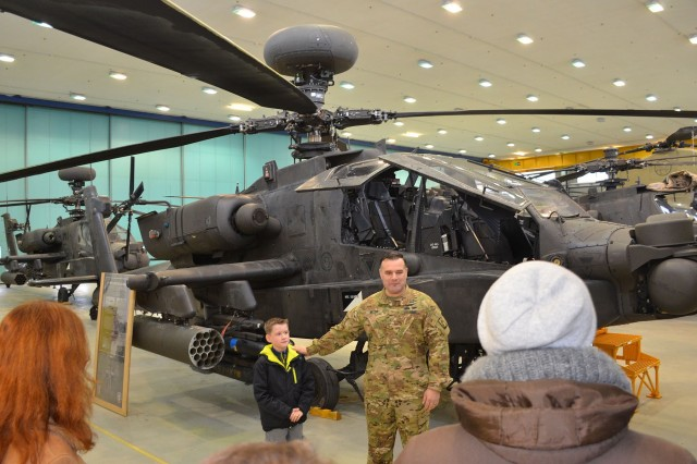 ANSBACH, Germany (Dec. 6, 2016)  -- The Ansbach Spouses and Civilians Club, together with the 12th Combat Aviation Brigade (12th CAB), and U.S. Army Garrison Ansbach (USAG Ansbach), invited more than 20 children from the Walburgisheim-Feucht Kinderheim (a children's home) to visit Katterbach Barracks Dec. 2 for a chance to experience American holiday celebrations and traditions. Children from the home, located about 9 miles south of Nürnberg in the town of Feucht, have been annual guests of the Ansbach community during the holidays for more than 30 years. American families and individual Soldiers acted as sponsors and hosts to the children during their visit.
