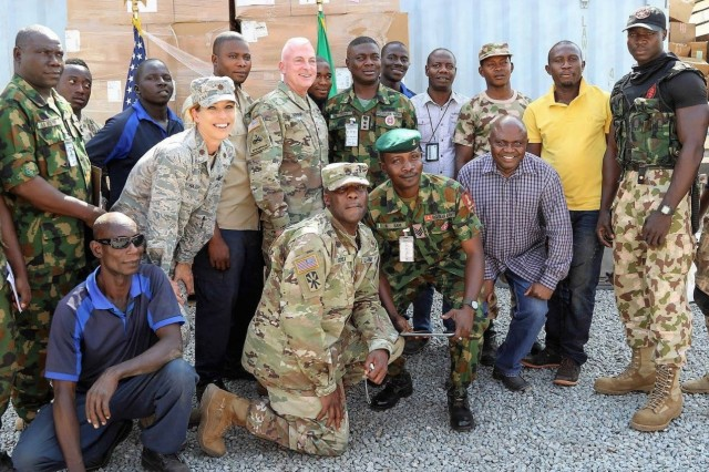 U.S. Army Africa Acting Commanding General Brig. Gen. Eugene LeBoeuf (center) poses for a group photo with U.S. service members and soldiers from the Nigerian Army in Abuja, Nigeria.  LeBoeuf's engagement in Nigeria also included a senior leader engagement with the U.S. ambassador to Nigeria and Nigeria's chief of army staff, and a speech to students at the Nigeria Army War College. (Courtesy photo/U.S. Embassy and Consulate in Nigeria)