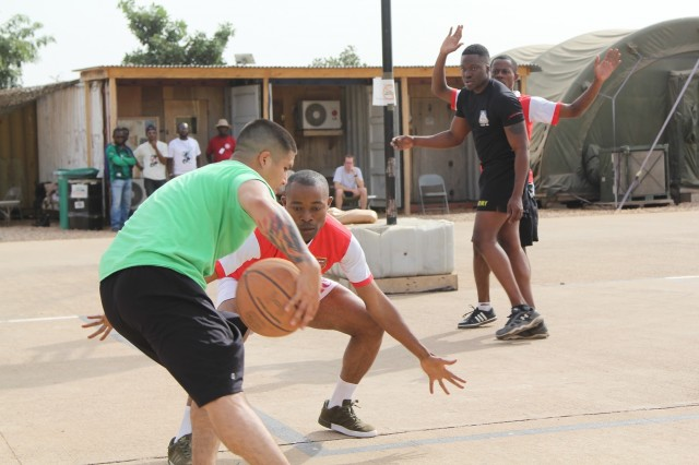 Staff Sgt. Steven Betancourt of Task Force Darby stationed at Contingency Location Garoua, attempts to drive the basketball past Capt. Patrick Ongong of the Cameroon Air Force Thanksgiving November 23 at CL Garoua. Members of the Cameroon Air Force and U.S. servicemembers shared Thanksgiving together. (Photo by Staff Sgt. Christina J. Turnipseed Contingency Location Garoua Public Affairs)