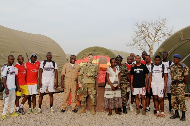 Maj. Andrzej V. Kujawski, Task Force Darby commander at Contingency Location Garoua poses with  Cameroonian Col. Barthelemy Tsilla (in fight suit), commander of Cameroon Air Base 301, and a few of his Airmen on CL Garoua Thanksgiving November 23. Members of the Cameroon Air Force and U.S. servicemembers shared Thanksgiving together. Members of the Cameroon Air Force and U.S. servicemembers shared Thanksgiving together. (Photo by Staff Sgt. Christina J. Turnipseed Contingency Location Garoua Public Affairs