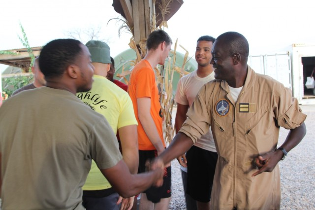 Col. Barthelemy Tsilla, commander of Cameroon Air Base 301 in Garoua shakes hands with US Servicemembers who won the Thanksgiving Day basketball tournament defeating both American and Cameroonian teams November 23. Members of the Cameroon Air Force and U.S. servicemembers shared Thanksgiving together. (Photo by Staff Sgt. Christina J. Turnipseed Contingency Location Garoua Public Affairs)