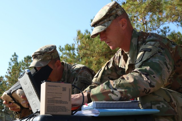 Staff Sgt. Justin S. Seeley, right, and Staff Sgt. Joshua Maynard, assigned to 1st Security Force Assistance Brigade, plot grid coordinates during a Master Unmanned Aircraft Systems Operator course, Nov. 3, 2017 at Fort Benning, Ga.  Soldiers interested in joining the 1st SFAB should contact their branch manager for more information. (U.S. Army photo by Sgt. Arjenis Nunez/Released)