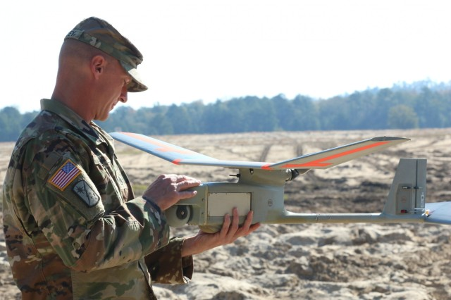 Staff Sgt. Justin S. Seeley, assigned to 1st Security Force Assistance Brigade, does a propeller check for the RQ-11B Raven unmanned aircraft system, Nov. 3, 2017 at Fort Benning, Ga. The RQ-11B Raven UAS is a small hand-launched remote-controlled unmanned aerial vehicle. Soldiers interested in joining the 1st SFAB should contact their branch manager for more information. (U.S. Army photo by Sgt. Arjenis Nunez/Released)