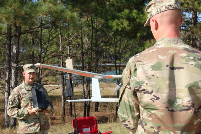 Staff Sgt. Justin S. Seeley and Staff Sgt. Joshua Maynard, assigned to 1st Security Force Assistance Brigade, do a functions check for the RQ-11B Raven unmanned aircraft system's stabilizer, for a Master UAS Operator course Nov. 3, 2017 at Fort Benning, Ga. The RQ-11B Raven UAS is a small hand-launched remote controlled unmanned aerial vehicle. Soldiers interested in joining the 1st SFAB should contact their branch manager for more information. (U.S. Army photo by Sgt. Arjenis Nunez/Released)