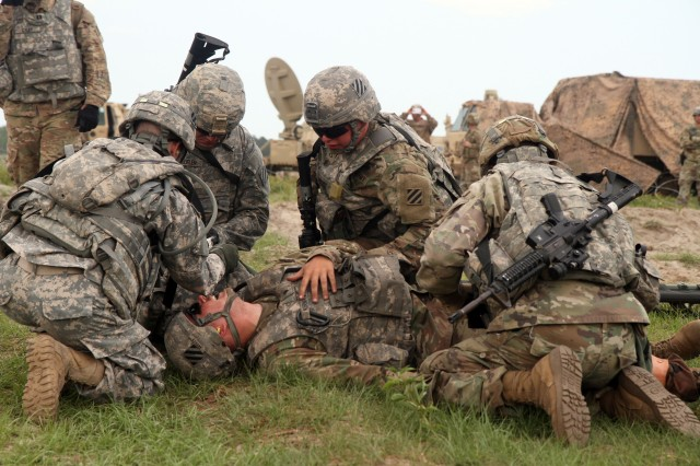 Soldiers from the 3rd Infantry Division Headquarters Battalion perform combat casualty care as part of medical evacuation training conducted in April 2017 at Fort Stewart, Georgia. The Army is looking for smaller, better technologies to operate in combat situations where prolonged field medical care will be common.