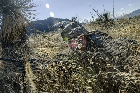 A Solider uses tall grass for concealment while preparing to attack an objective during the Vigilant Shield Exercise on White Sands Missile Range, N.M. Vigilant Shield is a U.S. Army Northern Command sponsored event to get Soldiers training conducting domestic security and other special missions.