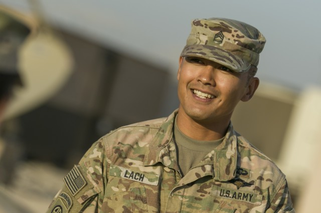 Sgt. 1st  Class Sokly Lach, intelligence analyst and B Co. First Sgt., 35th Infantry Division, Camp Arifjan, Kuwait, responds to questions about his military career and civilian life.