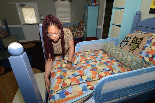 Gemma Clopton, the director of the 24/7 Lee Road Child Care Center in 2016, checks to ensure bedding at the facility is ready for children. The Department of Defense recently acknowledged Fort Jackson's youth services programs for having the 'highest level of program quality.'