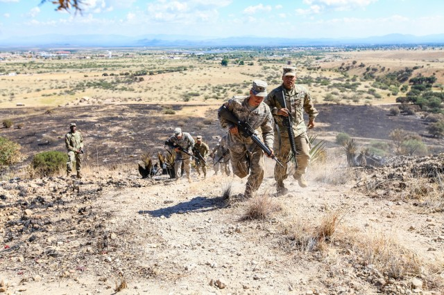Alpha Company, 40th Expeditionary Signal Battalion conducts a live fire exercise on Range 1B at Fort Huachuca, Arizona. (U.S. Army photo by Lara Poirrier)