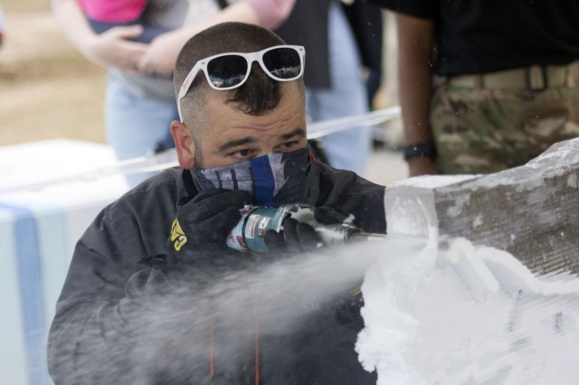 Fort Jackson community members not only got to see snow on post, Santa arrive by fire truck, but also witness a block of ice carved into a reindeer.