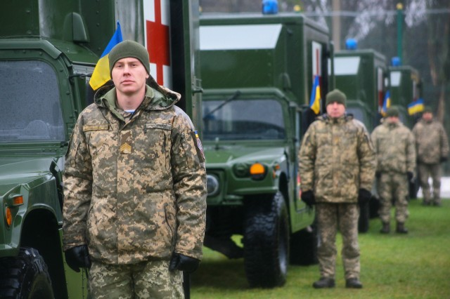 Yavoriv, Ukraine -- Ukrainian soldiers assigned to the Yavoriv Combat Training Center attend a Ukrainian Armed Forces Day ceremony Dec. 6. As part of the ceremony the United States presented the Ukrainian Ministry of Defense with 40 military ambulances. (U.S. Army photo by Sgt. Alexander Rector)