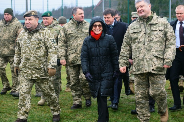 Yavoriv, Ukraine -- Marie Yovanovitch, the United States Ambassador to Ukraine, and Ukrainian President Petro Poroshenko attend a Ukrainian Armed Forces Day ceremony Dec. 6. As part of the ceremony the United States presented the Ukrainian Ministry of Defense with 40 military ambulances. (U.S. Army photo by Sgt. Alexander Rector)