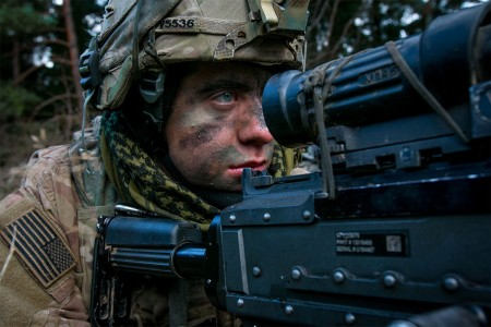 A Soldier assigned to 1st Infantry Division scans the terrain over the sights of his M-240 machine gun, Nov. 18, 2017, during an Allied Spirit VII training event in Grafenwoehr, Germany. The U.S. Army, along with its allies and partners, continues to forge a dynamic presence with a powerful land network that simultaneously deters aggression and assures the security of the region.