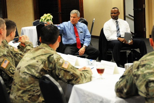 Retired Lt. Gen. Raymond V. Mason, Army Emergency Relief director, and retired Command Sgt. Maj. Charles Durr, AER financial assistance, meet with company commanders and first sergeants to discuss the commanders' referral program during a visit to Fort Rucker Nov. 30.