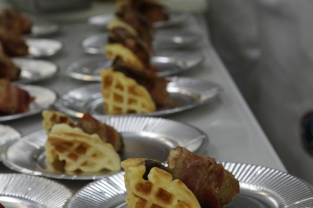 Team Mandoline, America's First Corps' team for the Iron Chief competition at Yama Sakura 73, designed a spin on the American dish, chicken and waffles, by wrapping the chicken with bacon and topping it with a sriracha maple syrup at Camp Sendai, Sendai, Japan, Dec. 3, 2017. The Iron Chief competition was between the 6th division and 9th Division of the Japan Northeastern Army, the 4th Japan Air Wing and I Corps. They had to prepare a chicken wing dish and a dessert.