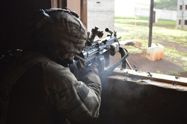 Infantrymen assigned to 2nd Battalion, 35th Infantry Regiment, 3rd Brigade Combat Team, 25th Infantry Division, fires his M4 carbine during a counterattack at Schofield Barracks, Hawaii, on Dec. 5, 2017. The Soldiers used Short-Range Training Ammunition for their squad room-clearing training at the installation's Military Operations in Urban Terrain (MOUT) site. (U.S. Army photo by Staff Sgt. Armando R. Limon, 3rd Brigade Combat Team, 25th Infantry Division)