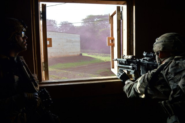 Infantrymen assigned to 2nd Battalion, 35th Infantry Regiment, 3rd Brigade Combat Team, 25th Infantry Division, scans through a window during squad room-clearing training at Schofield Barracks, Hawaii, on Dec. 5, 2017. The Soldiers used the Military Operations in Urban Terrain (MOUT) site to test their battle drill proficiency with realistic and dynamic conditions. (U.S. Army photo by Staff Sgt. Armando R. Limon, 3rd Brigade Combat Team, 25th Infantry Division)