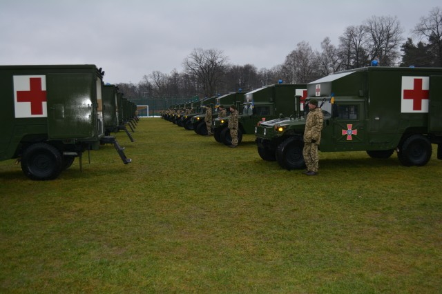 During a Ukrainian Armed Forces Day Ceremony at the Yavoriv Combat Training Center, Yavoriv, Ukraine, on December 6, the U.S. Army Europe presented the Ukrainian Ministry of Defense with 40 military ambulances.