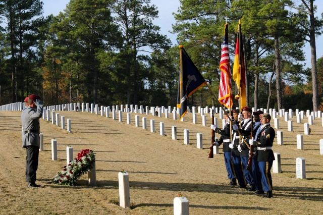 USASOC Soldiers and German military liaisons remember foreign WWII POWs buried at Fort Bragg, North Carolina, Nov. 30, 2017.