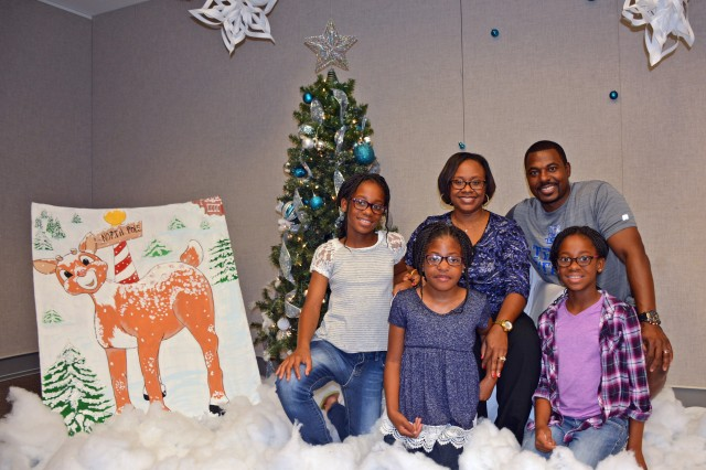 Jayla (left), Jaslyn (center) and Jaianna (right) Galbreath were the oldest set of triplets to attend the eighth annual NICU Graduate Reunion at Tripler Army Medical Center on December 3, 2017, with their parents Deanna Galbreath (left) and Retired Air Force Maj. Jarrad Galbreath (right).