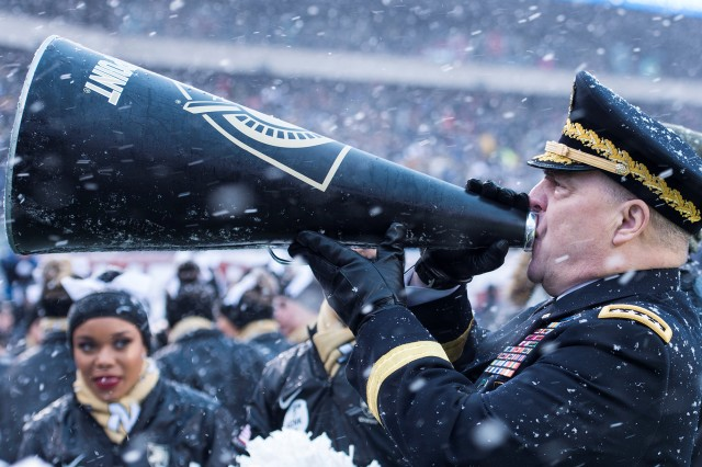 "Gen. Mark Milley, Army Chief of Staff, yells ""Go Army! Beat Navy!"" to the 4,000 cadets in attendance at the annual Army-Navy game. Milley honored seven Soldiers who participated in the hurricane relief efforts in Houston and Puerto Rico on Saturday."