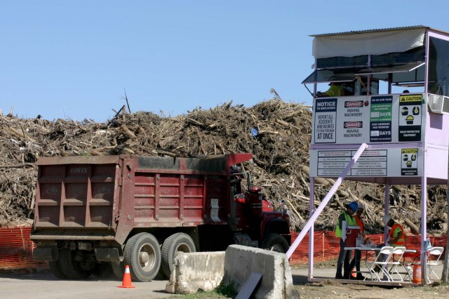 A truck hauling vegetative debris enters the Los Alamos Reduction Site in Guaynabo on Dec. 9, 2017. The day was significant in that the U.S. Army Corps of Engineers, with the help of locally-hired contractors, collected its 1 millionth cubic yard of debris on the island of Puerto Rico in the aftermath of hurricanes Irma and Maria. The milestone is significant in that it comes one day after the largest collection day since operations began, with 38, 239 cubic yards of debris collected Dec. 8.