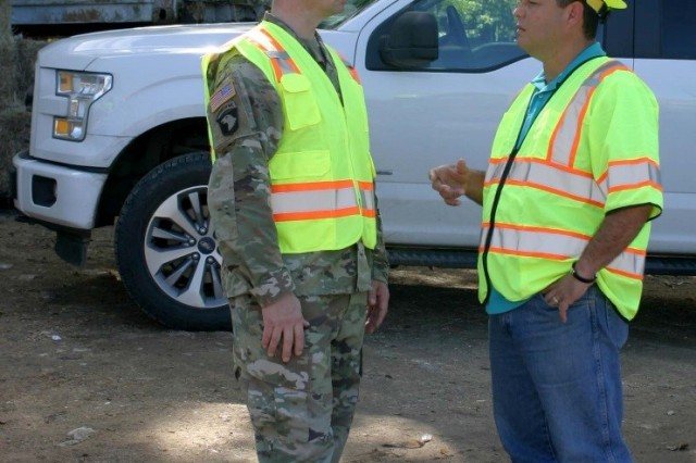 Lt. Col. Andrew Yoder, Recovery Field Office commander, meets with Guaynabo Mayor Angel Perez Otero, during an engagement at the Los Alamos Reduction Site in Guaynabo on Dec. 9, 2017. The day was significant in that the U.S. Army Corps of Engineers, with the help of locally-hired contractors, collected its 1 millionth cubic yard of debris on the island of Puerto Rico in the aftermath of hurricanes Irma and Maria. The milestone is significant in that it comes one day after the largest collection day since operations began, with 38, 239 cubic yards of debris collected Dec. 8.