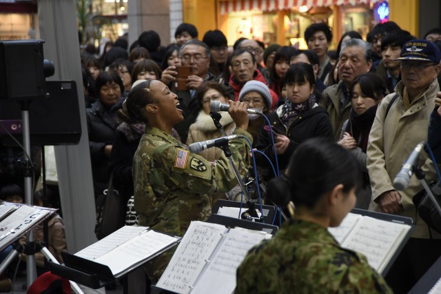 CAMP SENDAI, Japan -- Sgt 1st Class Patricia Conyers, U.S. Army I corps band, Joint Base Lewis-McChord, Washington alongside Japan Ground Self-Defense Force (JGSDF) service members perform Christmas numbers at Clis Road at the Shotengai Shopping District during Yama Sakura 73. Yama Sakura is an annual bilateral command post exercise involving the U.S. Military and the Japan Ground Self-Defense Force (JGSDF).The purpose of the exercise is to enhance U.S. and Japanese combat readiness and interoperability while strengthening bilateral relationships and demonstrating U.S. resolve to support the security interests of allies and partners in the Indo-Asia-Pacific region. During the exercise, U.S. military members and JGSDF members exchange ideas, tactics, techniques, military experiences, and culture. (U.S. Navy Photo by Mass Communication Specialist 2nd Marquis Whitehead/released)