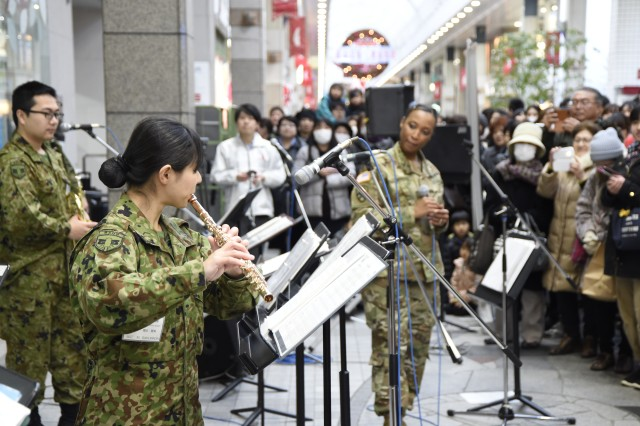 CAMP SENDAI, Japan --Japan Ground Self-Defense Force (JGSDF) service member performs flute solo alongside U.S. Army I corps band, Joint Base Lewis-McChord, Washington, at Clis Road at the Shotengai Shopping District during Yama Sakura 73. Yama Sakura is an annual bilateral command post exercise involving the U.S. Military and the Japan Ground Self-Defense Force (JGSDF).The purpose of the exercise is to enhance U.S. and Japanese combat readiness and interoperability while strengthening bilateral relationships and demonstrating U.S. resolve to support the security interests of allies and partners in the Indo-Asia-Pacific region. During the exercise, U.S. military members and JGSDF members exchange ideas, tactics, techniques, military experiences, and culture.