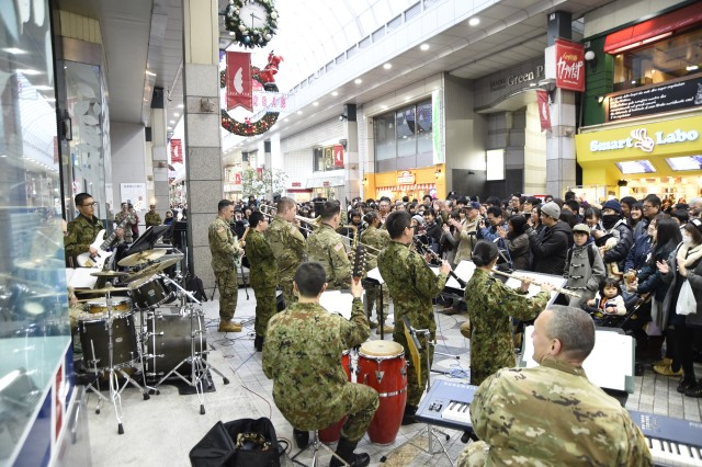 CAMP SENDAI, Japan -- U.S. Army I corps band, Joint Base Lewis-McChord, Washington, alongside Japan Ground Self-Defense Force (JGSDF) service members perform Christmas numbers at Clis Road at the Shotengai Shopping District during Yama Sakura 73. Yama Sakura is an annual bilateral command post exercise involving the U.S. Military and the Japan Ground Self-Defense Force (JGSDF).The purpose of the exercise is to enhance U.S. and Japanese combat readiness and interoperability while strengthening bilateral relationships and demonstrating U.S. resolve to support the security interests of allies and partners in the Indo-Asia-Pacific region. During the exercise, U.S. military members and JGSDF members exchange ideas, tactics, techniques, military experiences, and culture.