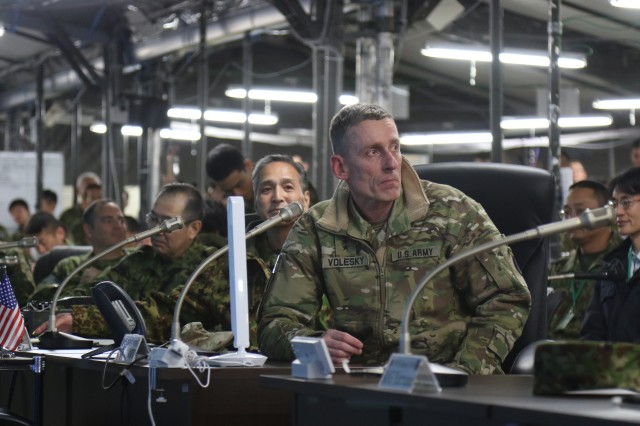 Lt. Gen. Gary J. Volesky, I Corps Commanding General, and Lt. Gen. Tetsuro Yamanoue monitor the notional battle during exercise Yaka Sakura 73, just prior to the conclusion of operations. Yama Sakura is an annual bilateral command post exercise involving the U.S. Military and the Japan Ground Self-Defense Force (JGSDF).