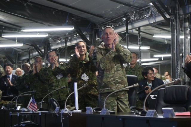 Lt. Gen. Gary J. Volesky, I Corps Commanding General, and Lt. Gen. Tetsuro Yamanoue and their staffs, celebrate victory of the notional battle during at the conclusion of exercise Yaka Sakura 73.