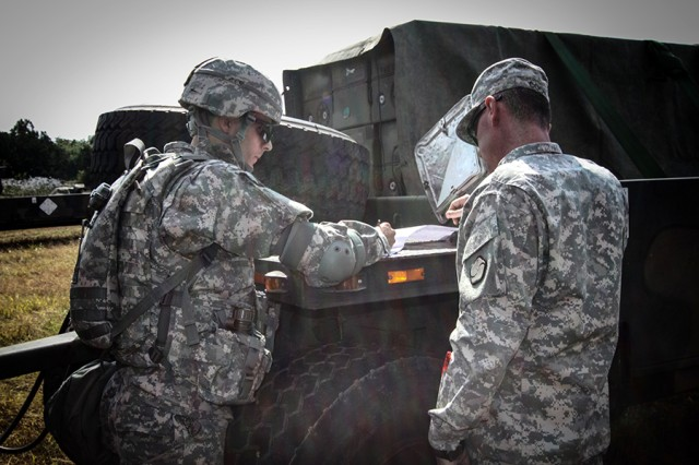 A convoy commander from the 2nd Combat Aviation Brigade verifies receipt of his notional stored combat load prior to leaving an ammunition supply point in the Republic of Korea on Oct. 30, 2014.