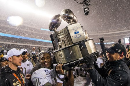Army quarterback Ahmad Bradshaw and the Army's coach, Jeff Monken, raise up the Commander in Chief's Trophy at the 118th Army-Navy Game in Philadelphia. Army beat Navy for the second straight year, 14-13, Dec. 9, 2017.