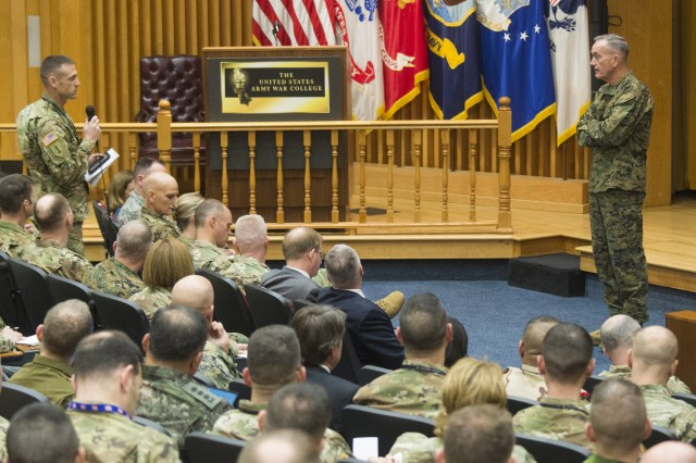 A student at the U.S. Army War College speaks to Marine Corps Gen. Joe Dunford, chairman of the Joint Chiefs of Staff, during a question and answer session at AWC in Carlisle, Pa., Dec. 7, 2017. Dunford visited the AWC to speak with students and staff.