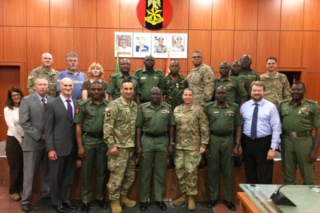 Armed Forces Nigeria and U.S. Army Africa's African Land Forces Summit pose for a group photo in AFN's headquarters in Abuja after introductions and discussion on plans and preparations for next years African Land Forces Summit.  ALFS is a weeklong seminar designed to give African land force's chiefs an opportunity to discuss and develop solutions for improving security and stability in their home country.