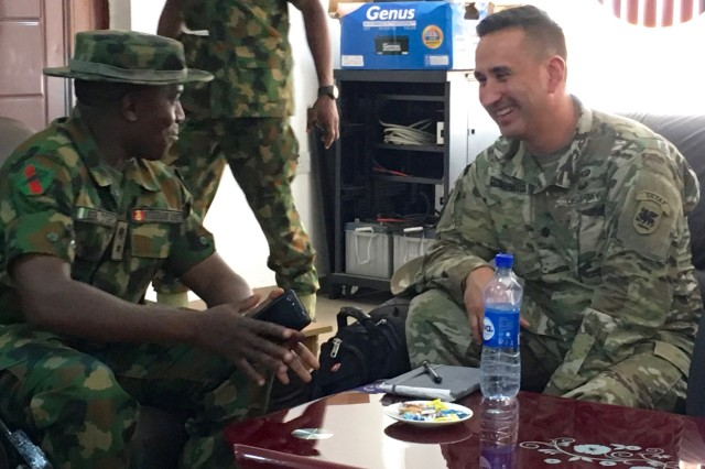 African Land Forces Summit 2018 lead planner, Lt. Col. Hector Montemayor (right) speaks with Lt. Col. Husaini Toro, 176th Guards Battalion commander at the proposed site for the summit's military demonstration in Abuja.  ALFS is a weeklong seminar designed to give African land force's chiefs an opportunity to discuss and develop solutions for improving security and stability in their home country.