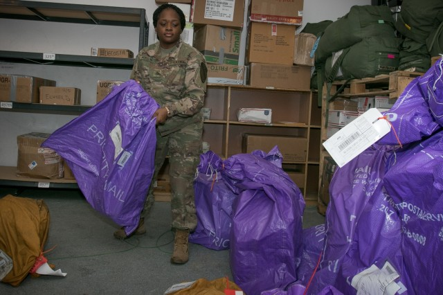 Private 1st Class Rodneisha Jackson, a mailroom clerk and Fitzgerald, Ga. native assigned to the 502nd Human Resources Company, 4th Sustainment Brigade, 1st Cavalry Division, sorts and organizes incoming mail near Powidz, Poland Dec. 8, 2017. Atlantic Resolve is a U.S. endeavor to fulfill NATO commitments by rotating U.S.-based units throughout the European theater to deter aggression against NATO allies in Europe.