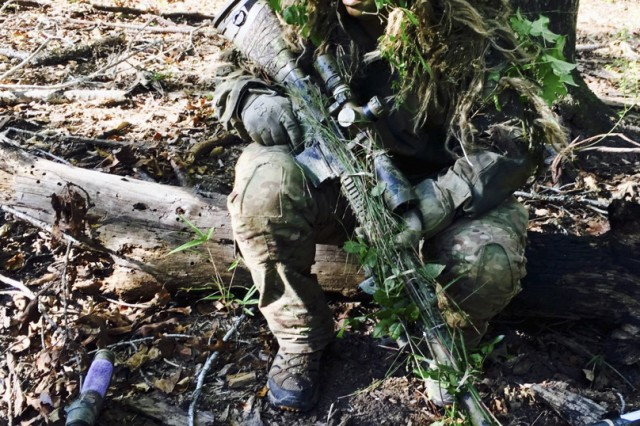 Specialist Adrian Leatherman, a sniper team leader with 1-23 Infantry, waits to proceed through a stalking lane during the International Sniper Competition at Fort Benning, Georgia, October 2017. Fort Benning is also the home of the U.S. Army Sniper School.