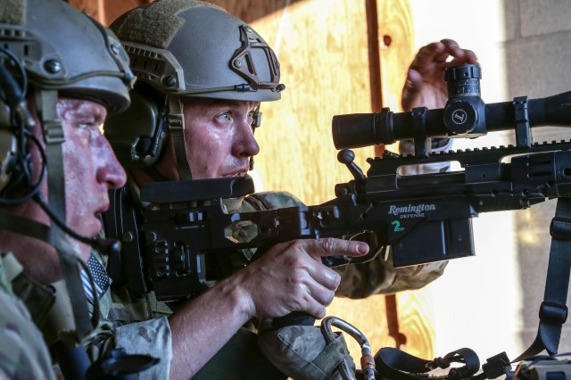 Green Berets assigned to the Special Forces Advanced Skills Company Sniper Detachment, 1st Special Forces Group (Airborne) make elevation adjustments to engage their target during an urban stress shoot on Joint Base Lewis-McChord, Wa., on 29 June, 2017.