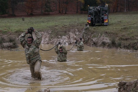 Soldiers of the 902nd Engineer Construction Company perform vehicle recovery operations in preparation of exercise Allied Spirit VII at the U.S. Army's Joint Multinational Readiness Center in Hohenfels, Germany, Nov. 5, 2017.