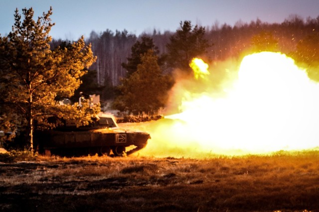 An M-1 Abrams tank from 5th Squadron, 4th Cavalry Regiment, 2nd Armored Brigade Combat Team, 1st Infantry Division, fires a round during training in Adazi, Latvia Dec. 9, 2017.